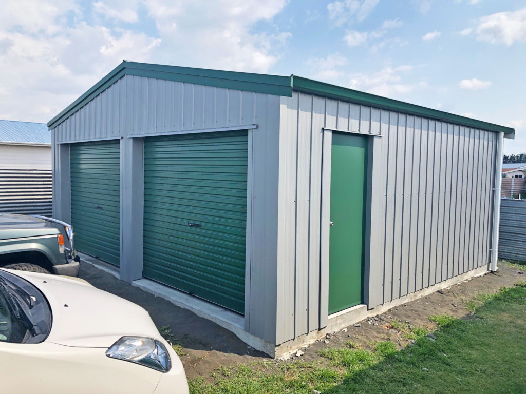 Small two bay garage with green cladding